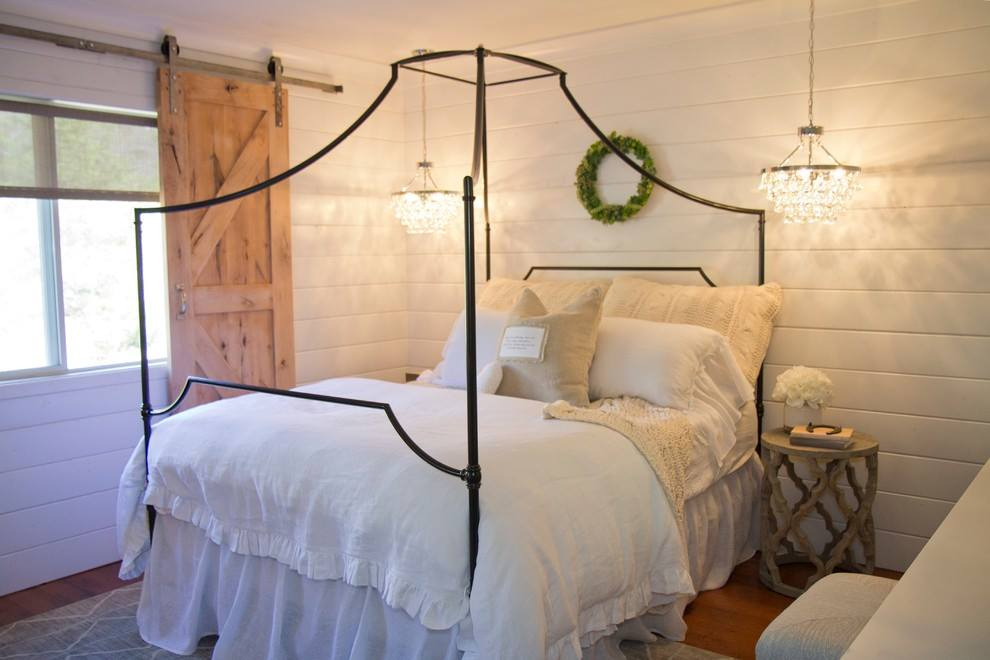 White Farmhouse Bedroom with Sliding Barn Door