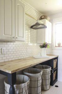 Farmhouse Style Laundry Room with Tile Backsplash