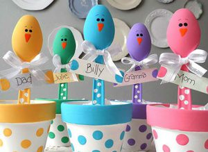 Easter place settings made with painted plastic spoons. www.womansday.com