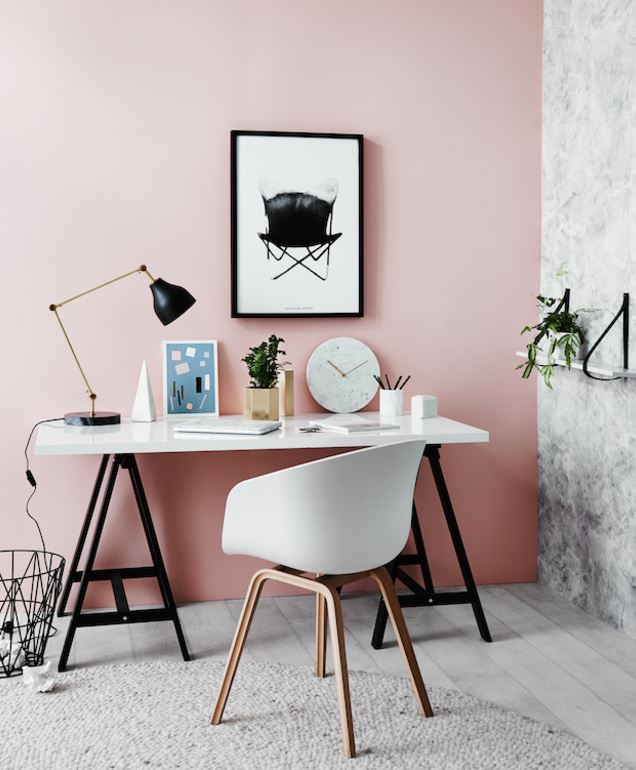 Nordic Design Interiors showcases a wall painted in a soft millennial pink.