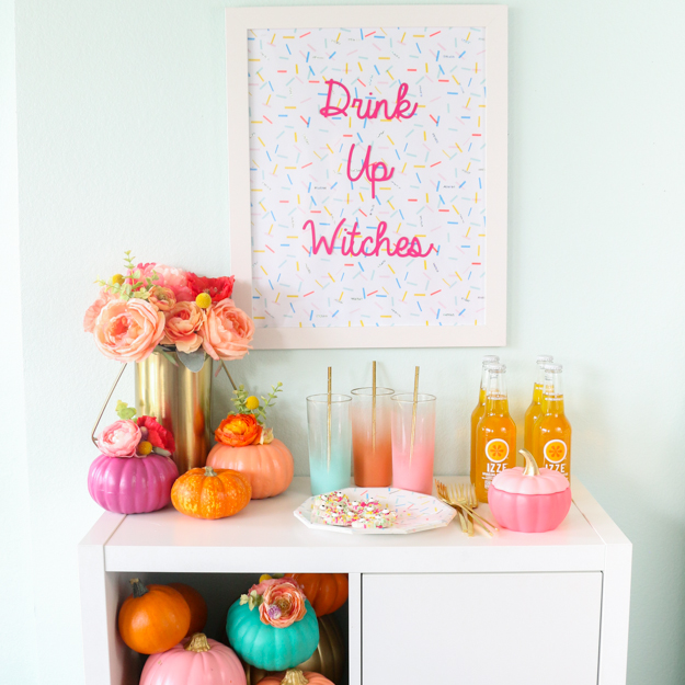 Paint your pumpkins using bold, bright colors and use them to decorate a cute mimosa bar or drink tray.