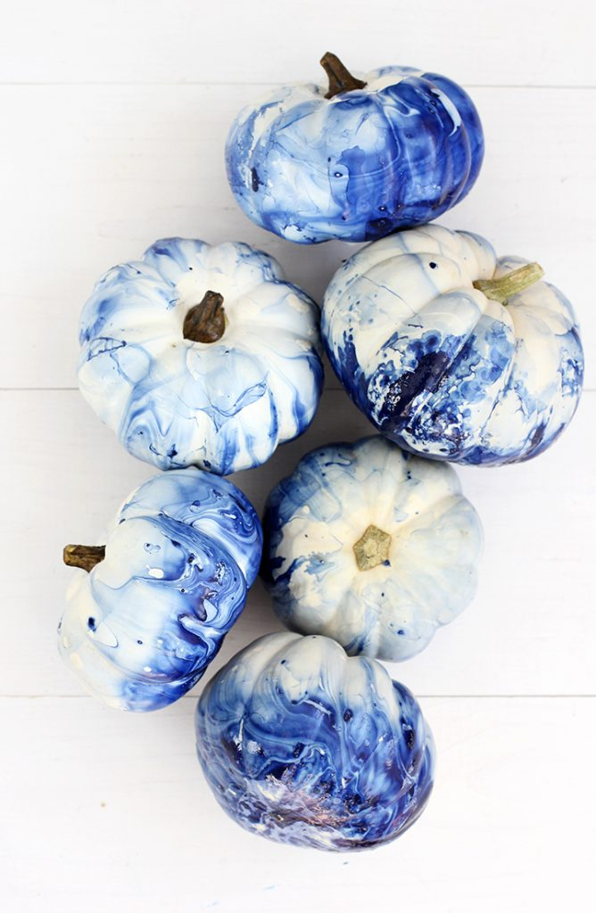 These indigo marbled pumpkins are a fun DIY project to glam up your fall decor.