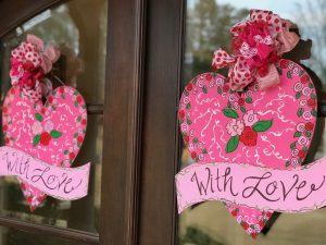 Festive pink Valentine's Day door hangers