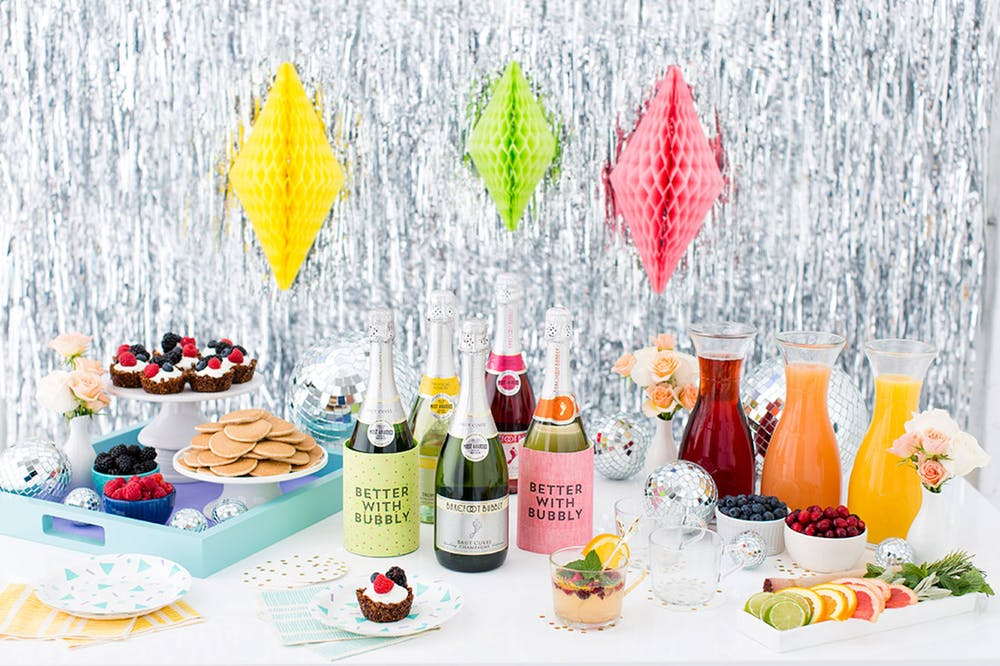 make your own mimosa bar this step by step guide from britco is a great way to greet shower guests at noon on a summer weekend