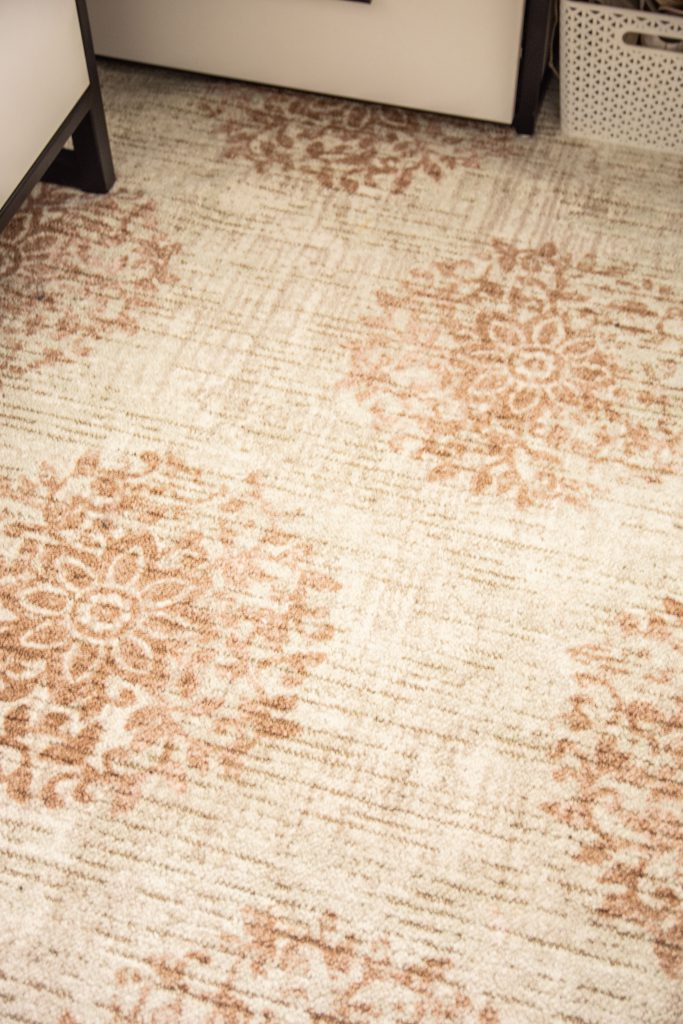 The floral design in the Relic Jardin area rug by Mohawk Home is subtle with a bit of a vintage feel.