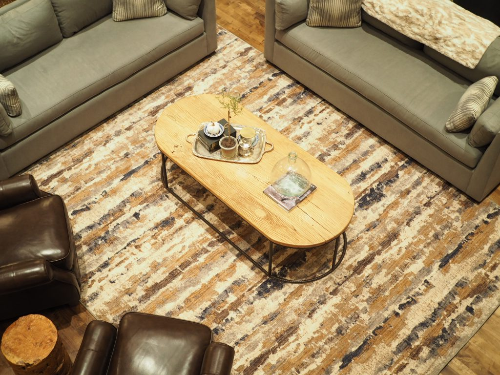 how to arrange furniture around an area rug