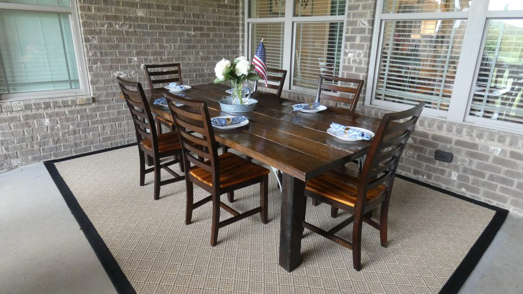 Redecorated sunmer time patio with Mohawk Home indoor/outdoor area rug