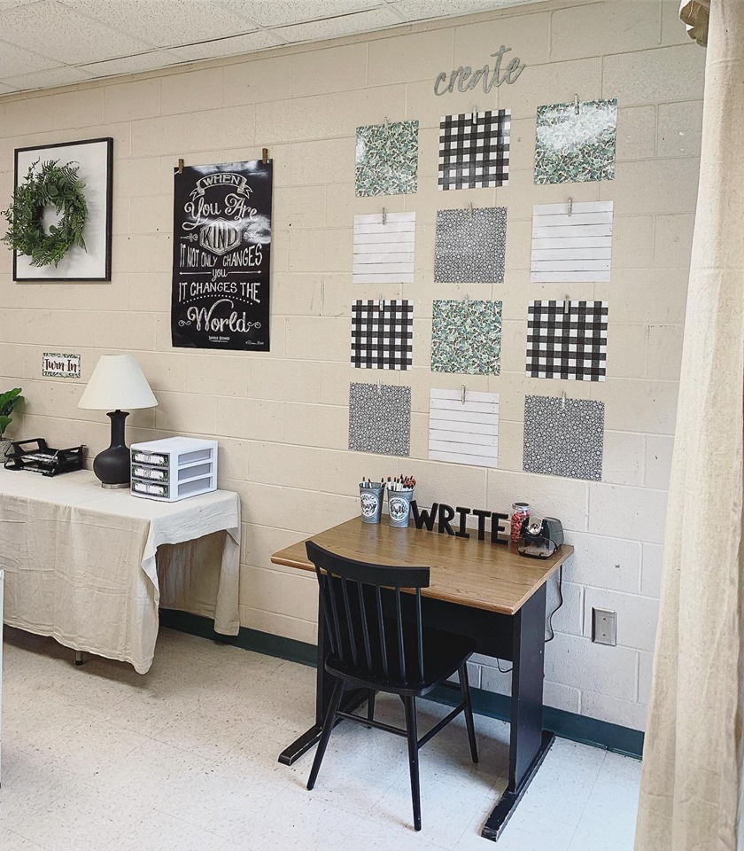 Writing desk with tin bucket pencil holders and an 'outstanding work' wall display using farmhouse scrapbook paper