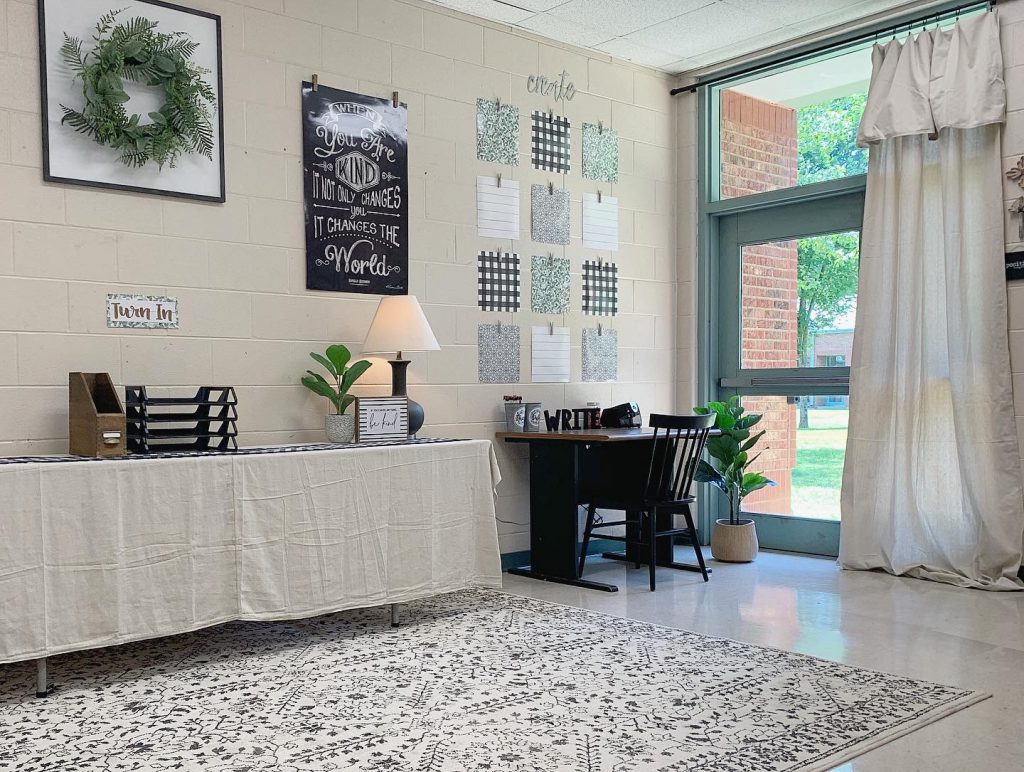 A rustic drop cloth table cover and drop cloth curtains add a touch of farmhouse style to this classroom.