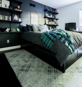 Teen boy bedroom interior with Mohawk Home Russell Plaid area rug