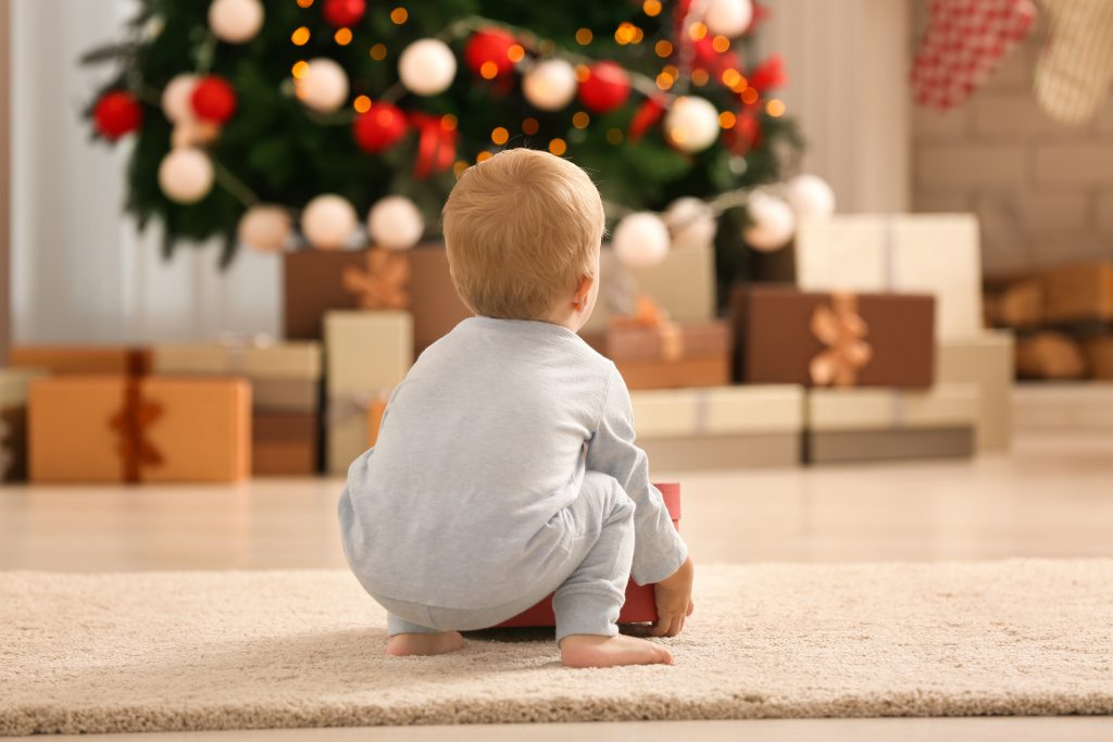 Baby looks at Christmas tree