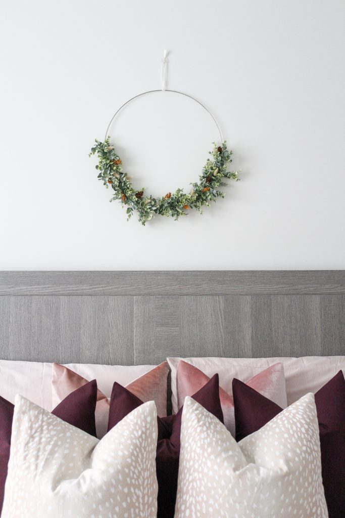 Green wreath hung over the master bed
