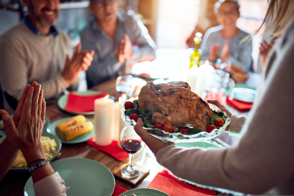 celebrating the holidays with friends and family over a delicious meal