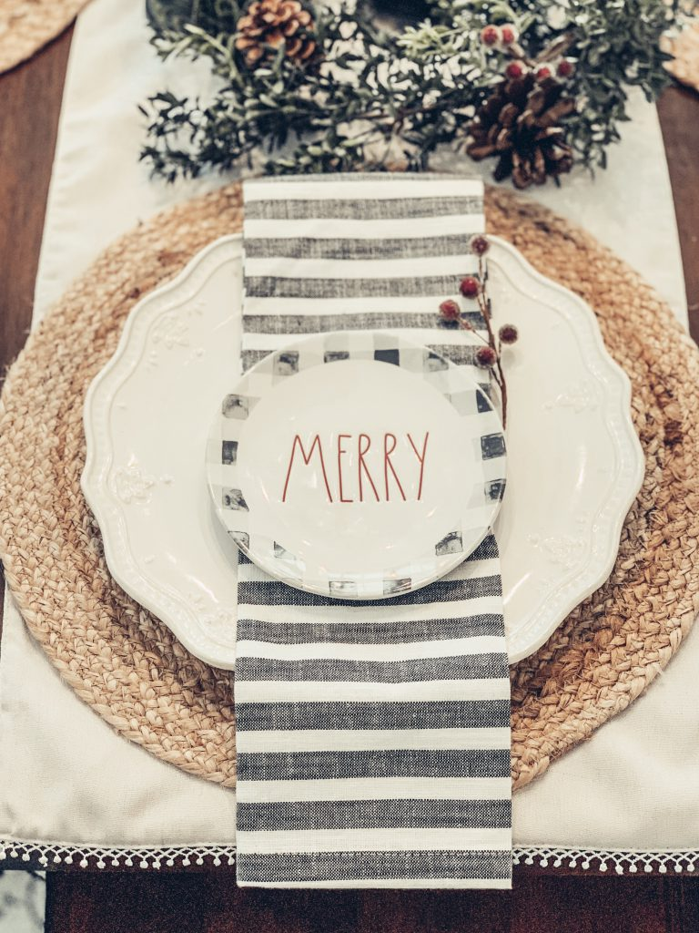 Holiday place setting with jute placemat and Merry sign